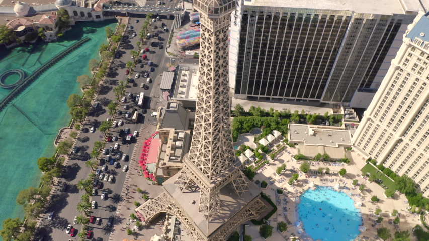 Drone flight over The Strip, Las vegas, Nevada. Jul 2019. 4k. View on Eiffel Tower, famouse hotels and traffic. Sunny day at famouse movies locations. Sleepy city after crazy night.