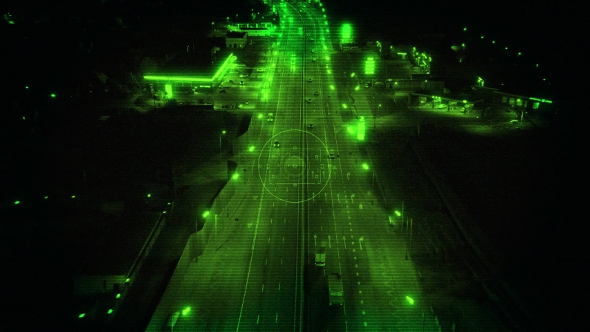 Night Vision from Drone with Zoom In, Tracking the Truck Driving on Highway at Night