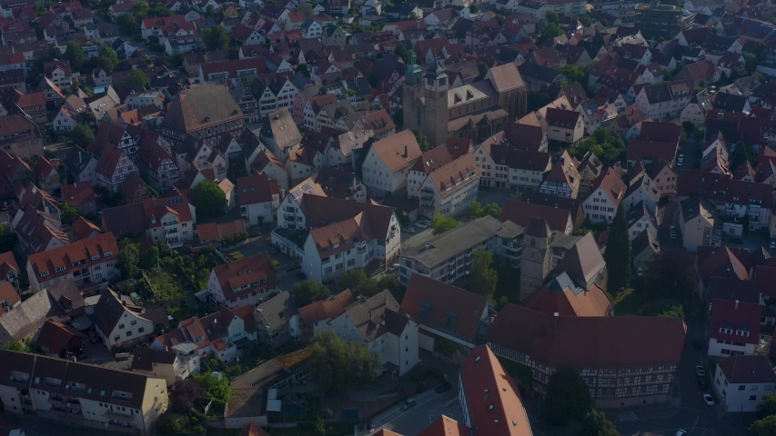Aerial of the old part of town from Markgroningen in Germany.  Camera rotates right around Bartholomaus Church and the old town. | Shutterstock HD Video #1032962093