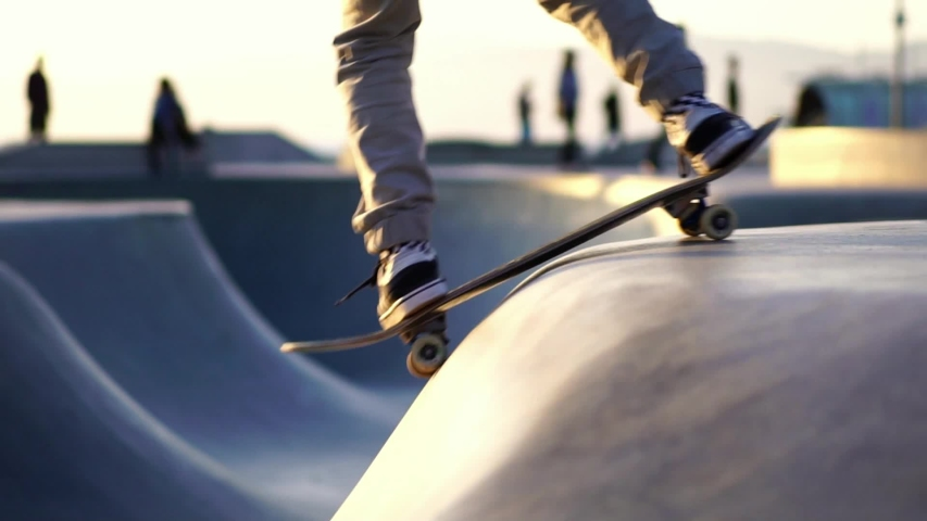 Skateboarder skateboarding in Venice Beach skate park Los Angeles, California. Concept of healthy millennial active lifestyle, skateboarding & summer travel. Slow Motion. LA is host city 2028 olympics | Shutterstock HD Video #1032968123