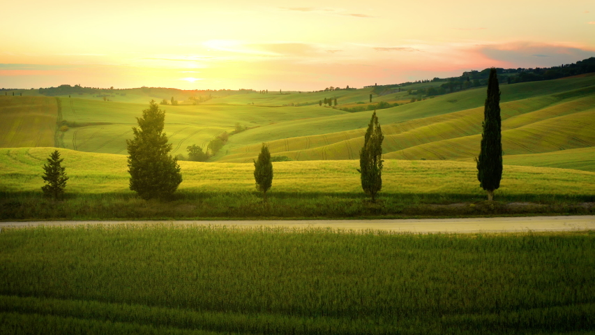 Flying over the amazing rolling hills of Tuscany Italy at sunset