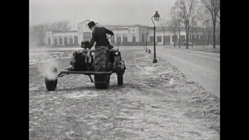 CIRCA 1930 - A three wheel vehicle is demonstrated in 1937.