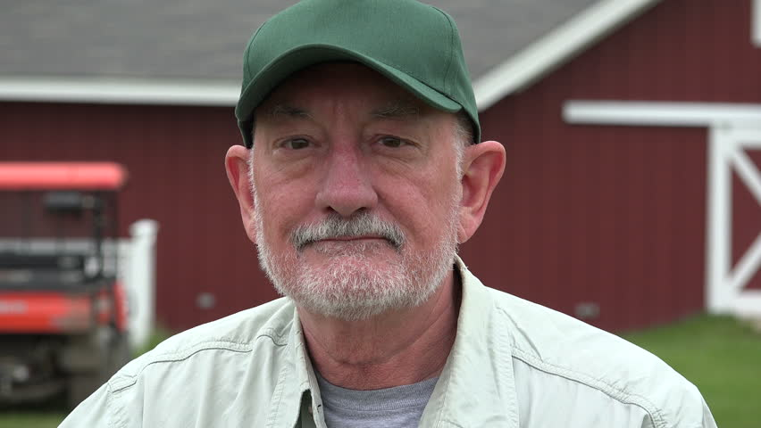 Farmer in front of his barn, close up portrait
