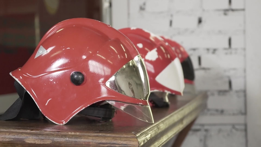 Close-up slow motion shot of fireman's helmet on the table. Emergency, danger, protection concept. | Shutterstock HD Video #1033003013