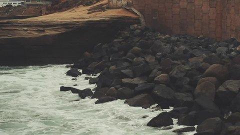 waves splashing in slow motion against rocks