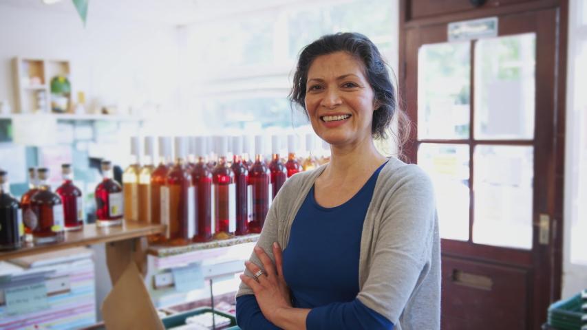 Portrait Of Mature Woman Running Organic Farm Shop   Shutterstock HD Video #1033022639