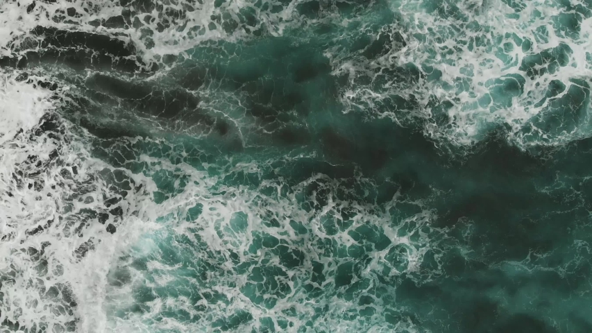 Aerial view of the Atlantic coast, aquamarine color of the waves falling on the beach of volcanic origin, Tenerife, Spain #1033023065