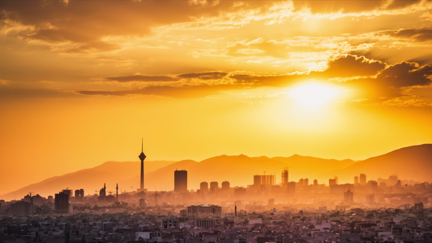 4K Tehran-Iran time-lapse with milad tower in the frame cityscape timelapse of Tehran city from day to night with beautiful sunset.
