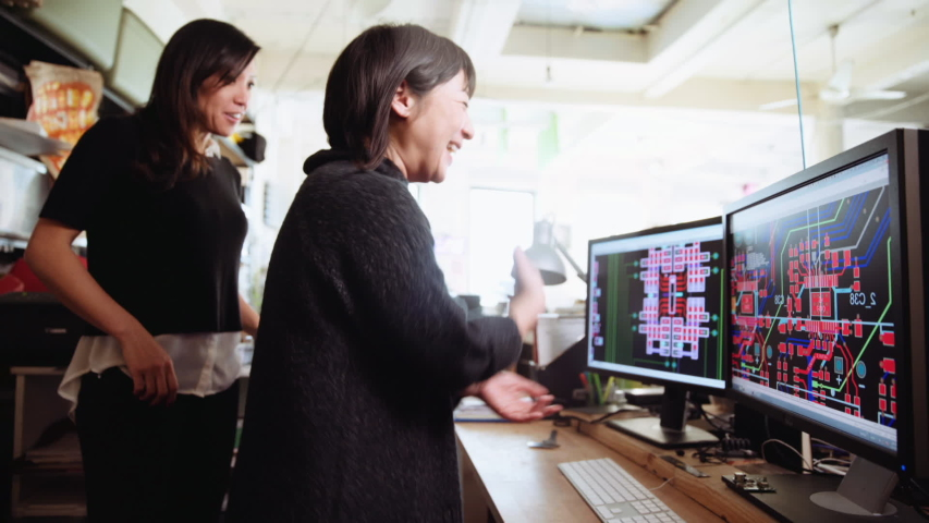 Asian women working with computers in office Royalty-Free Stock Footage #1033063163