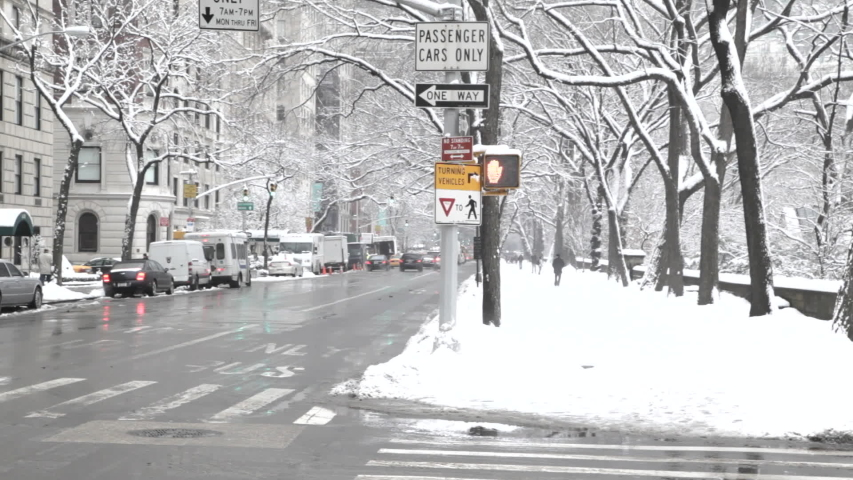 Cars and snow on Fifth Avenue, New York City
