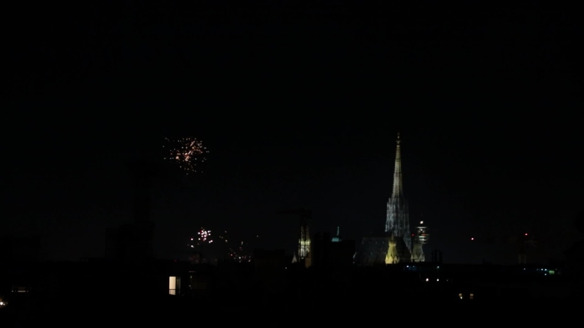 City Center of Vienna, Austria at New Year's Eve. Different angle. Various firework displays. St. Steven's Cathedral within shot.   Shutterstock HD Video #1033073627