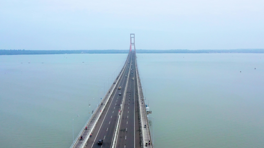 Aerial landscape of Suramadu bridge on the Madura strait in East Java, Indonesia. Shot in 4k resolution from left to right | Shutterstock HD Video #1033082444