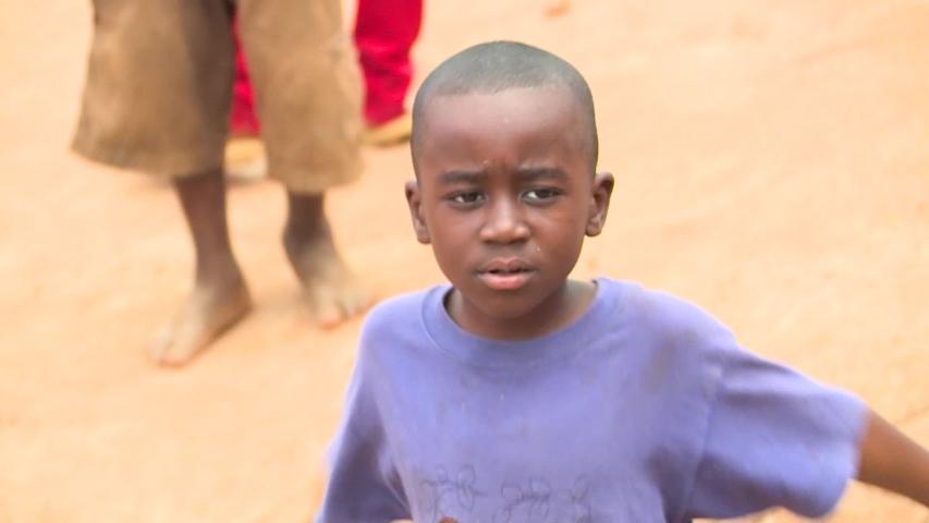 Kigali, Rwanda - 02 02 2018: KIGALI, RWANDA, FEBRUARY 2018: Close-Up portrait portrait of local children in the street. Kigali,Rwanda