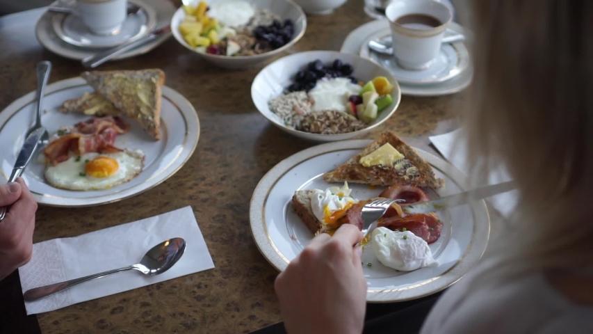 SLOWMO - Young couple having healthy breakfast at a luxury resort | Shutterstock HD Video #1033086341
