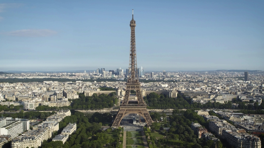 Aerial shot of the Eiffel Tower from the Champ de Mars with the Trocadero and La Defense business district in the background. 4K long focal drone shot of the Eiffel Tower - La Tour Eiffel par drone. | Shutterstock HD Video #1033094063