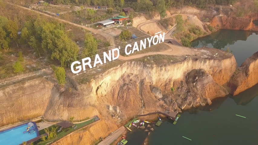Grand Canyon sign and park In Chiang Mai, Thailand. Aerial drone footage Orbit shot above Hangdong water park Reservoir from old soil mine. Hang Dong GrandCanyon Tourist attraction Thai land