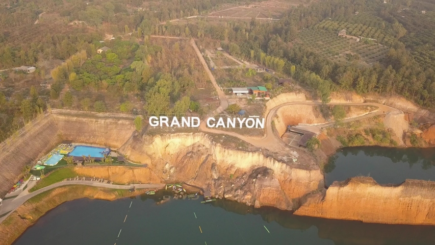 Grand Canyon sign and park In Chiang Mai, Thailand. Aerial drone footage above Hangdong water park Reservoir from old soil mine. Hang Dong GrandCanyon Tourist attraction Thai land