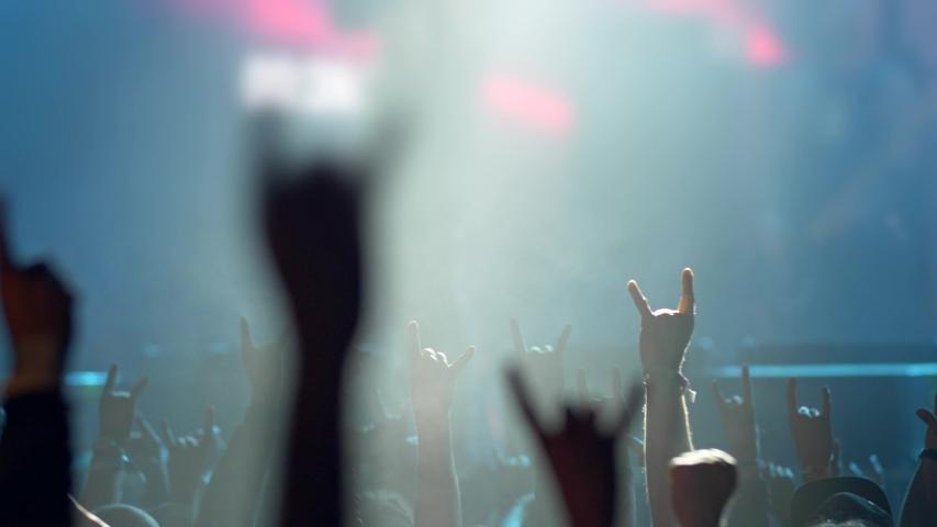 Crowd raising up their hands applauding the musicians on great concert summer musical festival | Shutterstock HD Video #1033105676