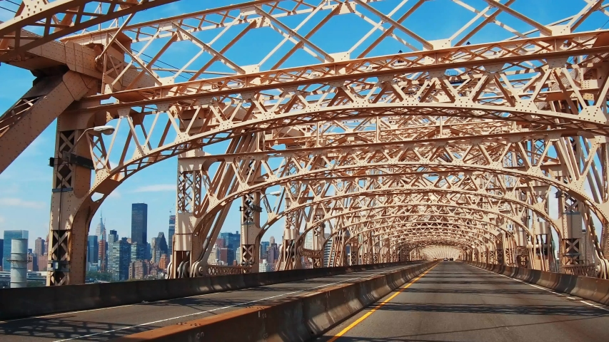 Driving on Queensboro Bridge on a sunny day connecting New York City midtown to Brooklyn | Shutterstock HD Video #1033110251
