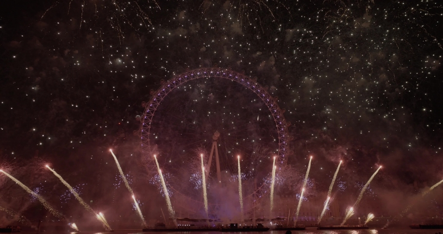 London, Outside US or Canada / United Kingdom (UK) - 01 01 2019: The Mayor of London's New Year Fireworks Display 2018 / 2019 Fireworks light up the Thames as thousands of spectators gather to watch t