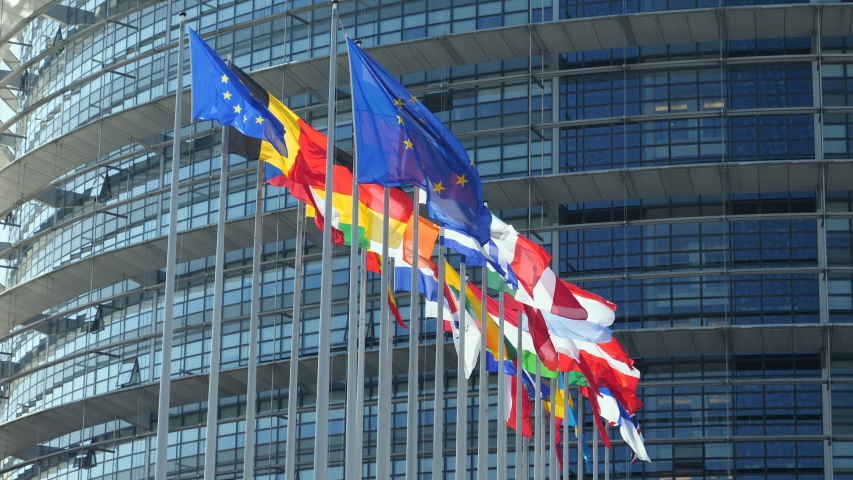 European Union Flags waving calmly in front of European Parliament building in Strasbourg France includes United Kingdom flags Royalty-Free Stock Footage #1033138259