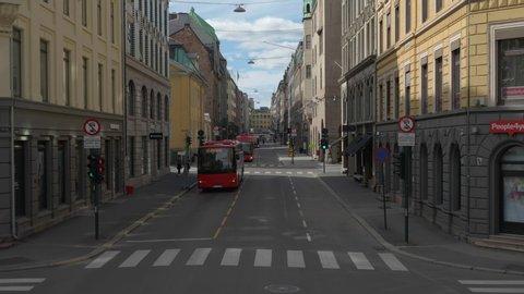 Oslo, Østlandet / Norway - 08 25 2018: Buses travelling through urban street of Oslo, Norway