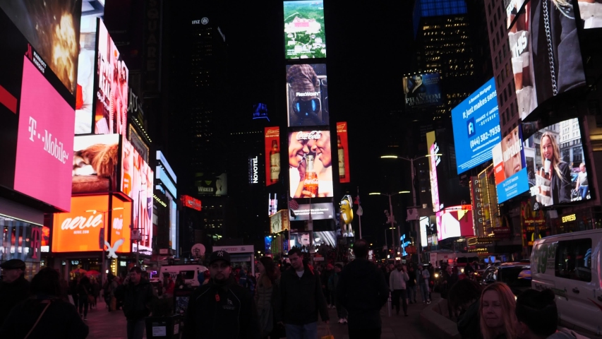 New York City, New York / United States - 12 12 2018: walking on time square in new york city during night