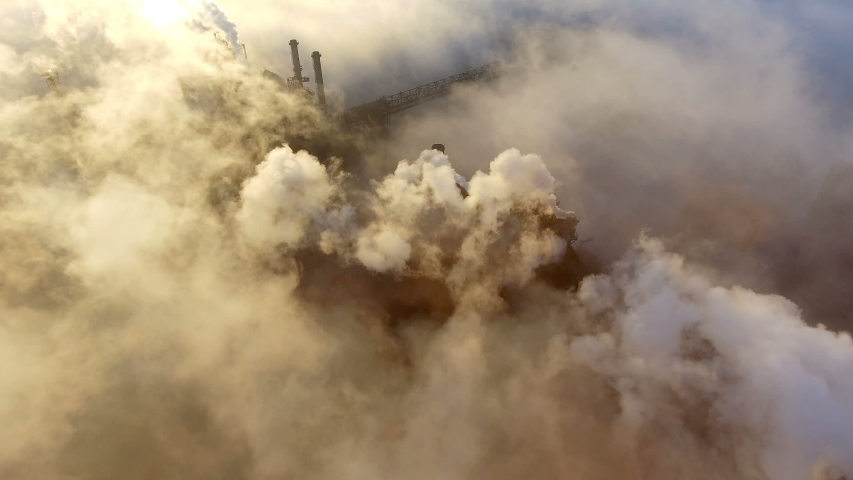 Aerial view. Emission to atmosphere from industrial pipes. Smokestack pipes shooted with drone. | Shutterstock HD Video #1033163957