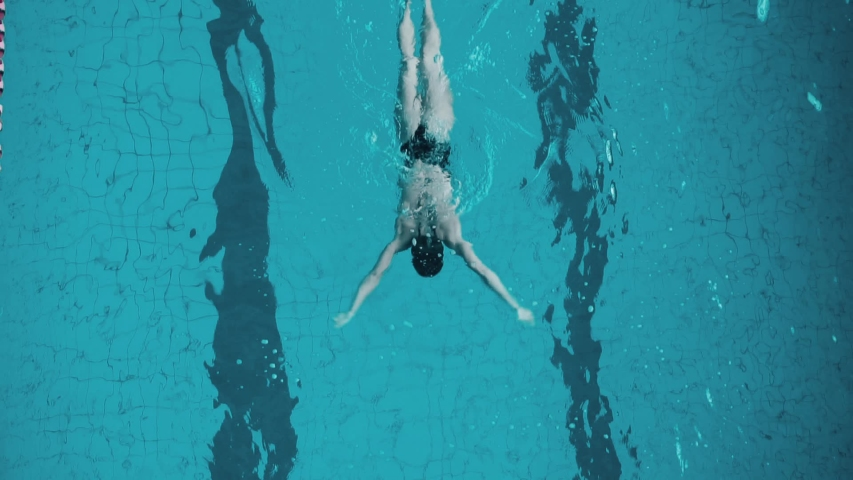 Young woman in indoor swimming pool, Slow motion   Shutterstock HD Video #1033188470