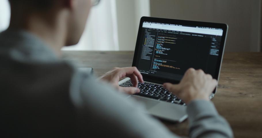 Closeup coding on screen, Man hands coding html and programming on screen laptop, development web, developer. Royalty-Free Stock Footage #1033204724