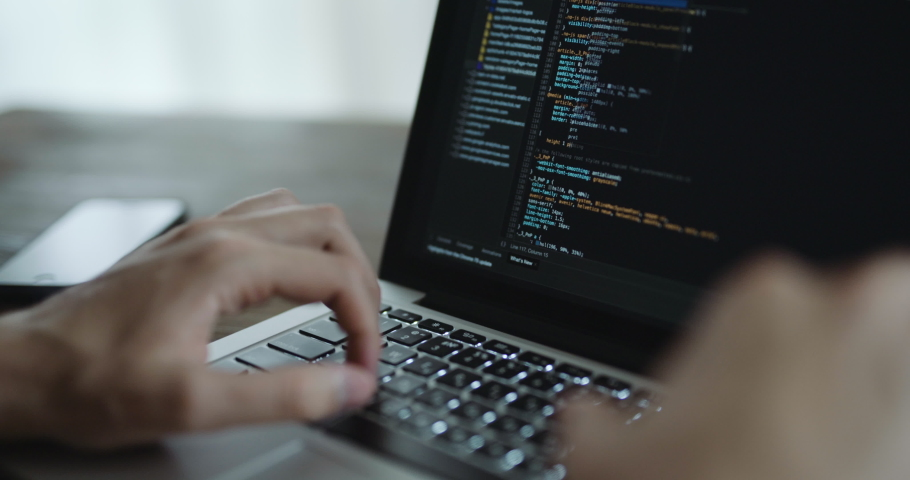 Closeup coding on screen, Man hands coding html and programming on screen laptop, development web, developer. Royalty-Free Stock Footage #1033204736