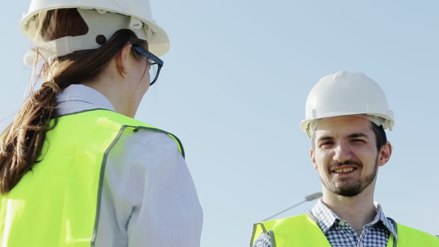 Unidentified Woman And A Male Engineer A Project Foreman Agree On The Construction Of A New Home In An Urban Area. Concept Improvement Of Urban Space | Shutterstock HD Video #1033216826