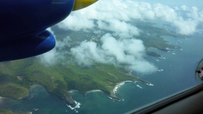 Epic aerial view from the bn2 islander flying over the Caribbean island of Grenada