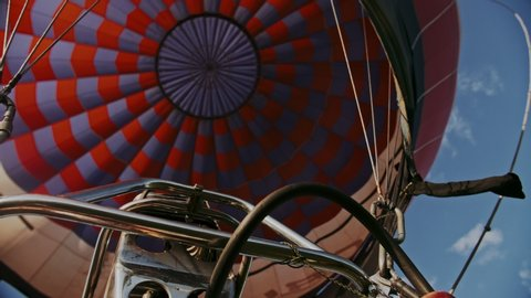 Hot air burning to the air balloon. During the flight