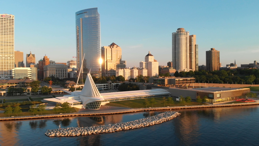 Aerial view of american city at dawn. High-rise  buildings, Michigan lake shoreline, Milwaukee Art Museum.  Sunny morning. Milwaukee, Wisconsin, USA