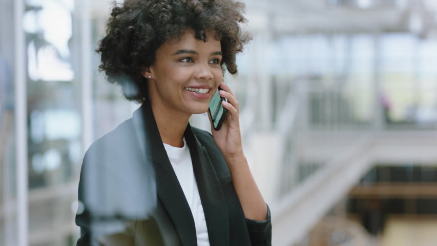 Business woman using smartphone having phone call chatting on mobile phone enjoying conversation with client at work in office | Shutterstock HD Video #1033254221