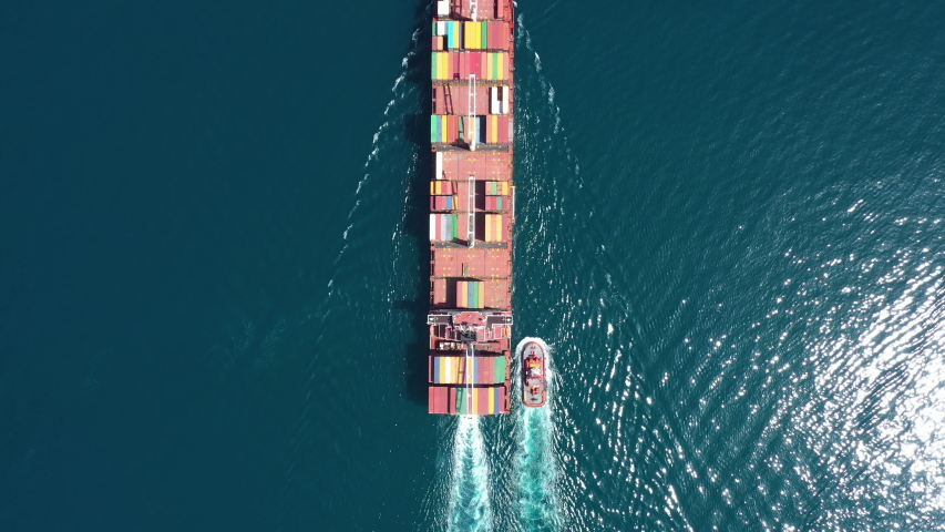 Aerial view of Cargo ship. Large container ship at sea - Aerial top down.