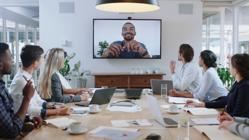 group of business people having conference call meeting in boardroom team leader man chatting to colleagues using online video chat on tv screen discussing ideas in office 4k Royalty-Free Stock Footage #1033254908