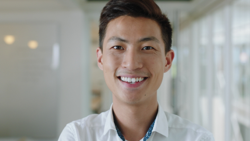portrait young asian businessman smiling enjoying successful career proud entrepreneur in office workplace testimonial 4k footage #1033257185
