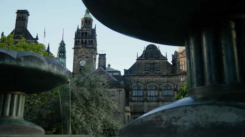 Town hall in distance shot through fountains at Peace Gardens Sheffield City Centre Sheffield Town Hall Main central building key location land mark tourist attraction clock tower 4K 25p   Shutterstock HD Video #1033263704