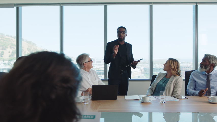 Corporate business people meeting in boardroom brainstorming colleagues discussing strategy sharing problem solving ideas collaborating in office 4k | Shutterstock HD Video #1033264322