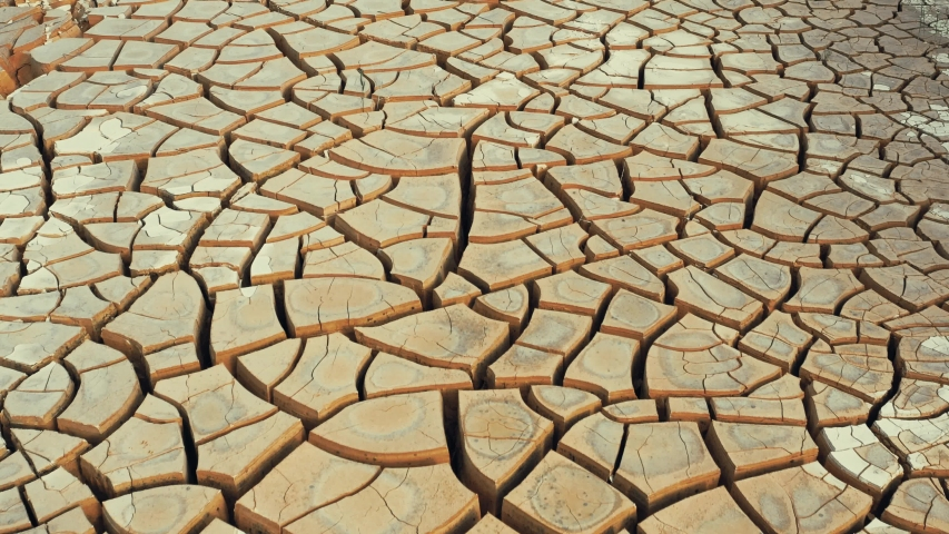 Desert. Aerial view of a beautiful cracks in the ground. texture, deep crack. Effects of heat and drought. effects of global warming. cracked desert landscape | Shutterstock HD Video #1033277606