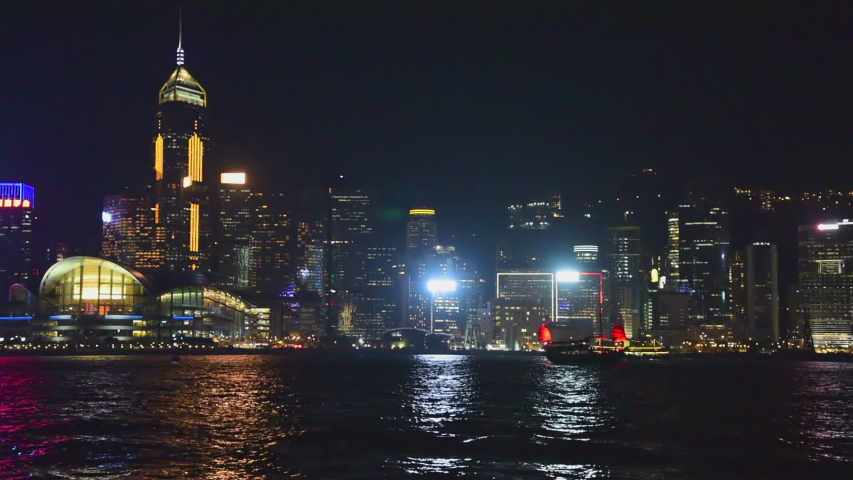 Wide Angle: The Flashing Lights on the Buildings of Hong Kong at Night   Shutterstock HD Video #1033297340