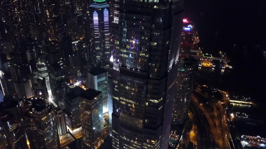 Aerial: Panning Down Skyscraper in Hong Kong City at Night | Shutterstock HD Video #1033297697