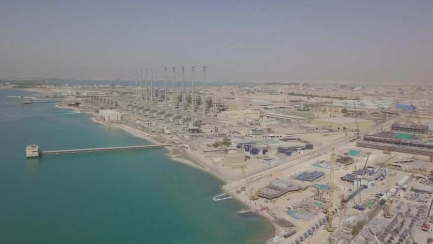 Saudi desalination plants and vessel with large crane (4K)