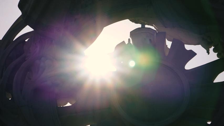 Sun rays make their way through architecture | Shutterstock HD Video #1033334594