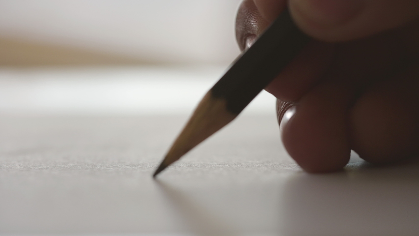 Close-up writing on a piece of paper. Writing love letters | Shutterstock HD Video #1033337153