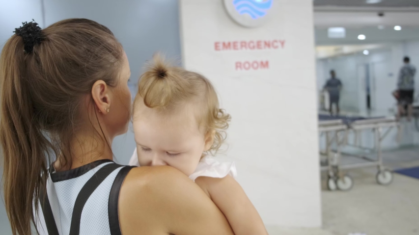 Mom and child come in in the emergency room at the hospital in Pattaya Thailand Royalty-Free Stock Footage #1033351670