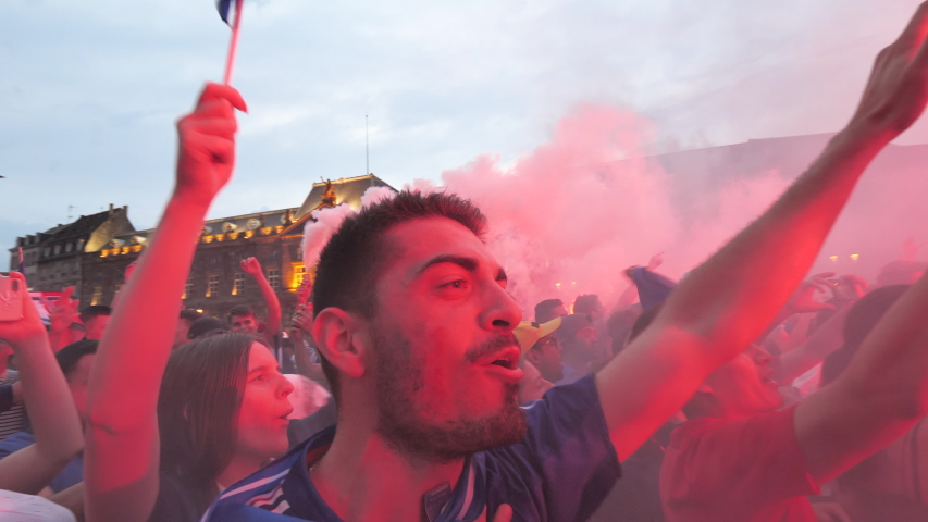 STRASBOURG, FRANCE - JULY 15, 2018: Crowd singing la Marseillaise Happiness and jubilation of supporters after the victory of the French team in the final of the World Cup football against Croatia