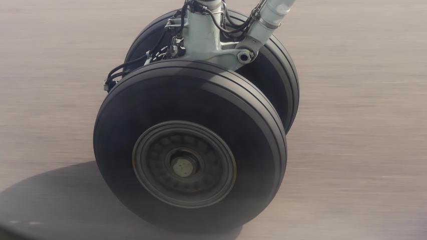 View on airplane wheel at landing, 4k close up shot